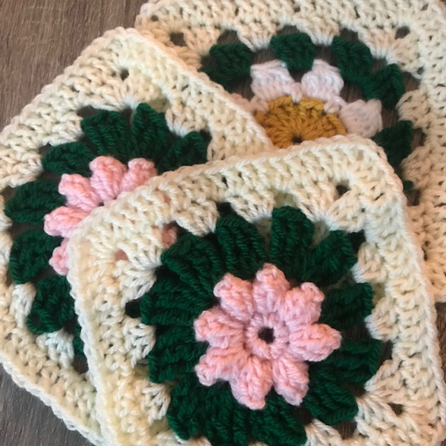 how to crochet a flower granny square using Lion Brand Yarn by Erica Jackofsky